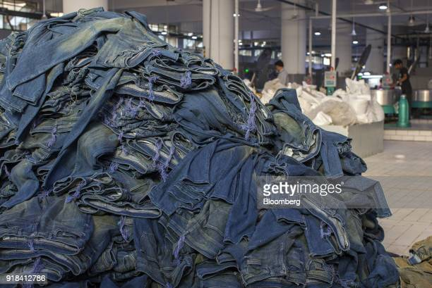 A pile of jeans sit in the washing unit of the Artistic Denim Mills Ltd factory in Karachi Pakistan on Tuesday Feb 6 2018 Pakistans manufacturers...