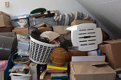 Pile of junk in a house, hoarder room pile of household equipment needs clearing out