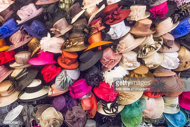 A pile of ladies hats