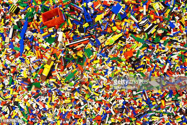 pile of laid out lego pieces - lego stock pictures, royalty-free photos & images