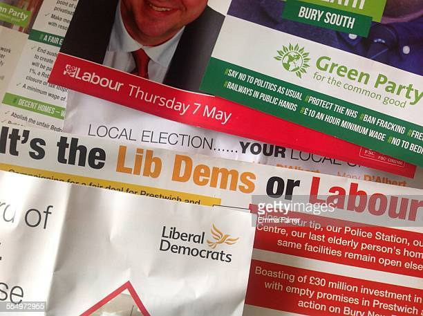 Pile of leaflets from various UK political parties which have been delivered to homes in the run up to the General Election