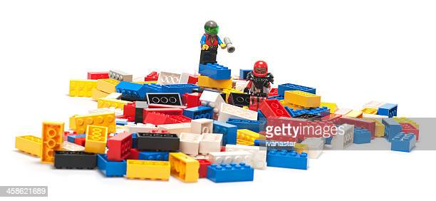 Pile of Lego Blocks with Astronaut Figurines on Top