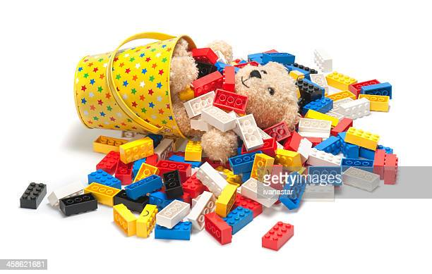 Pile of Lego Blocks with Teddy Bear