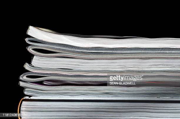 pile of magazines and books - reading stock pictures, royalty-free photos & images