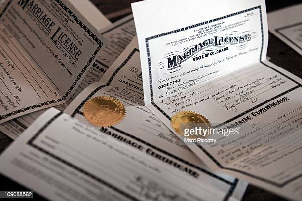 A pile of marriage licenses await the officiant's signature at Loveland Ski Area in Colorado after the 20th Annual Marry Me Ski Free Mountaintop...