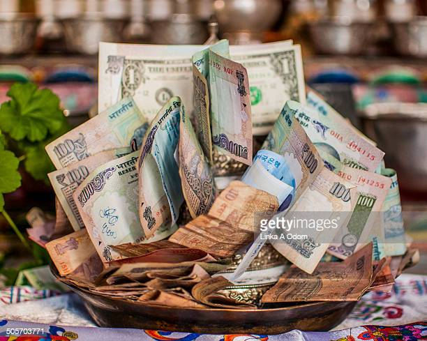 A pile of money in a monastery bowl