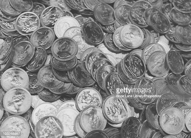 A pile of newlyminted sovereigns at the Royal Mint in London 13th November 1974 They are 22 carat gold