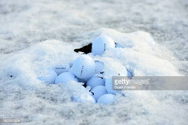 A pile of Nike practice balls is seen on the driving range as the start of the continuation of round one is delayed due to snow on the course during...