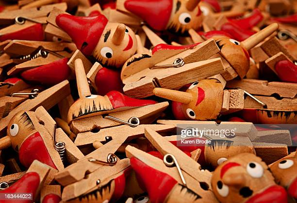 a pile of novelty clothes pegs at a market stall - karen price stock pictures, royalty-free photos & images