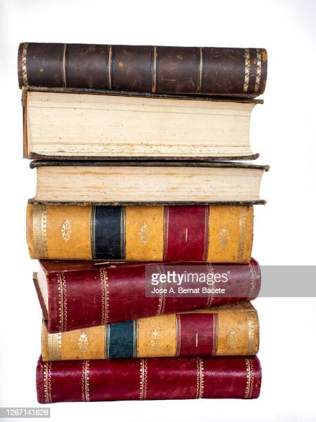 pile of old books on a white background. - stack stock pictures, royalty-free photos & images