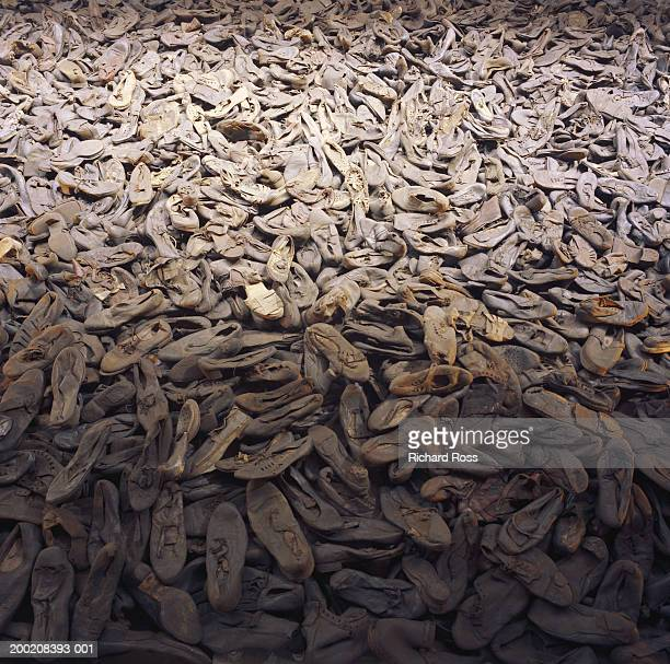 pile of old shoes at jewish memorial, full frame - holocaust stock pictures, royalty-free photos & images