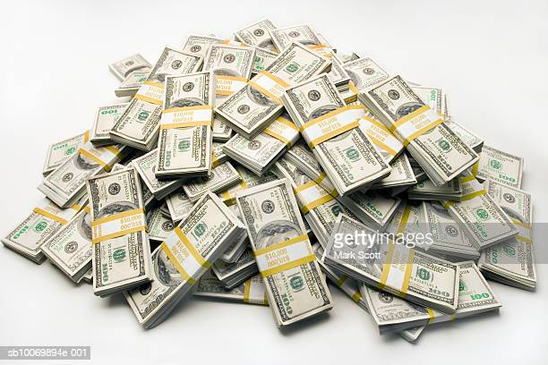 Pile of one hundred dollar bills in bundles