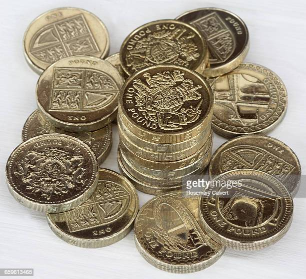 Pile of one pound coins with stack at centre.