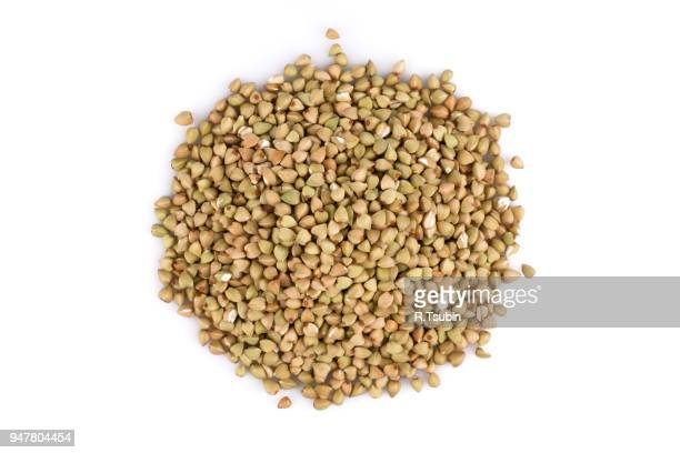 pile of organic bio buckwheat raw on white background - buckwheat stock pictures, royalty-free photos & images