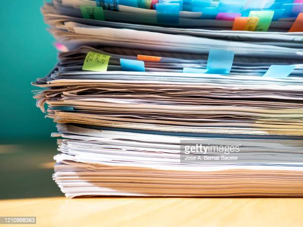 pile of papers on a work table. - report document ストックフォトと画像
