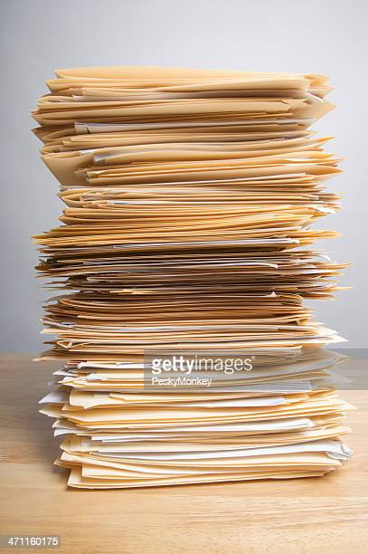 Pile of Paperwork on Wood Desk