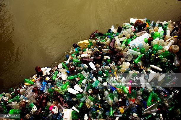 Pile Of Plastic Bottles In River