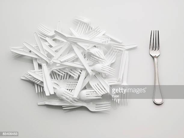 pile of plastic forks and silver fork - mismatch stock pictures, royalty-free photos & images
