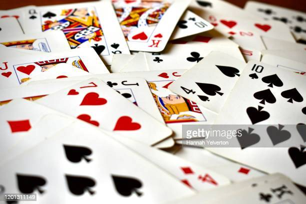 pile of playing cards face up - poker card game stock pictures, royalty-free photos & images