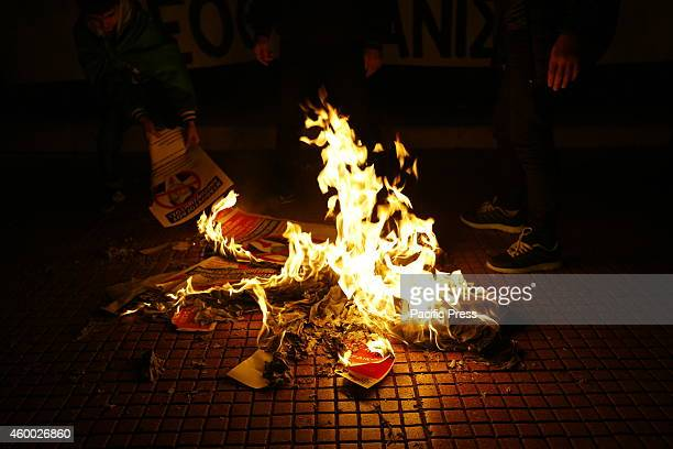 PANEPISTIMIO ATHENS ATTICA GREECE A pile of poster with the picture of the Turkish Prime Minister Ahmet Davutolu burn during the protest Kurdish...