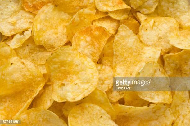 pile of potato chips - ポテトチップス ストックフォトと画像