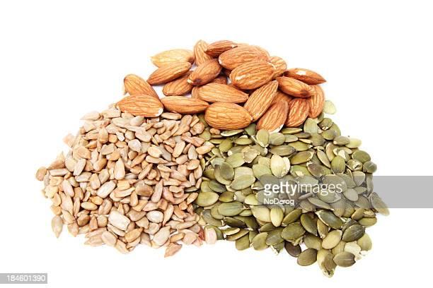 Pile of pumpkin and sunflower seeds with almonds