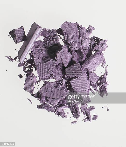 pile of purple eye shadow, overhead view - purple eyeshadow stock photos and pictures