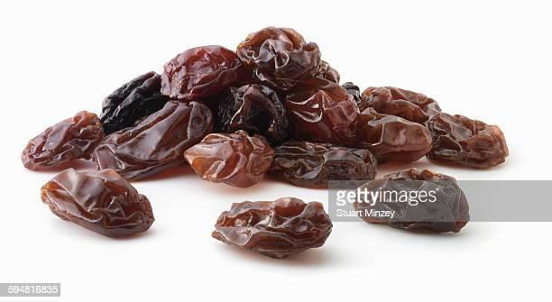Pile of raisins on white background