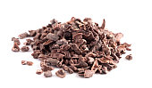 A Pile of Raw Chocolate Nibs on a White Background