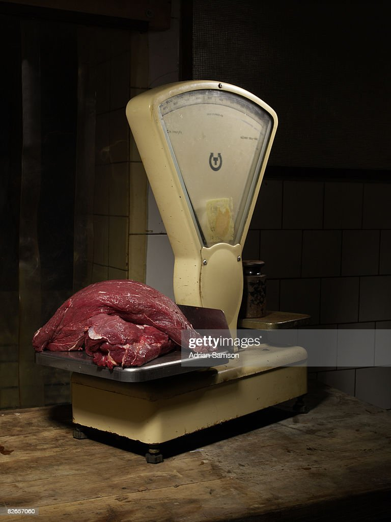 Pile of raw meat on scales : Stock-Foto