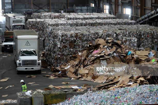 A pile of recycled cardboard sits on the ground at Recology's Recylce Central on January 4 2018 in San Francisco California Recycle centers are...