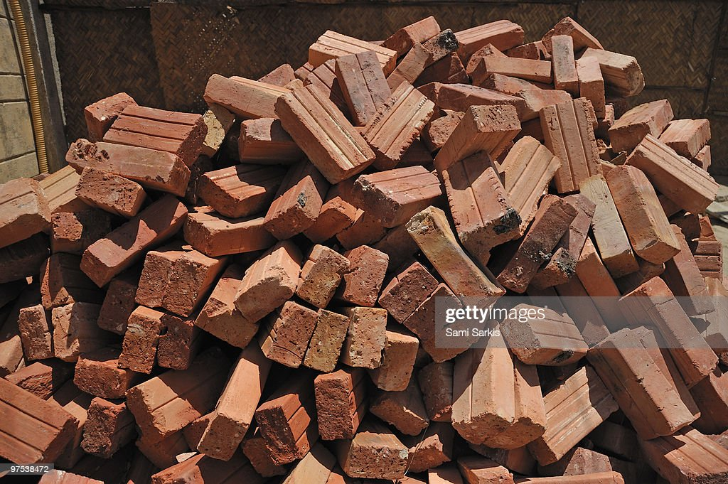 Pile of red bricks in construction site : Stock Photo