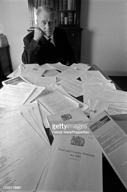 Pile of regulations and Planning Acts restricting architects and builders exhibited by barrister 2nd Baron, Lord Dougall Meston, of the National...