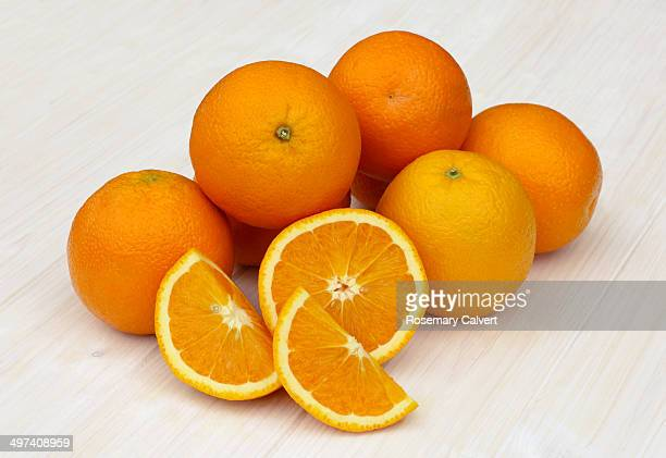 Pile of ripe, juicy, organic oranges on white.