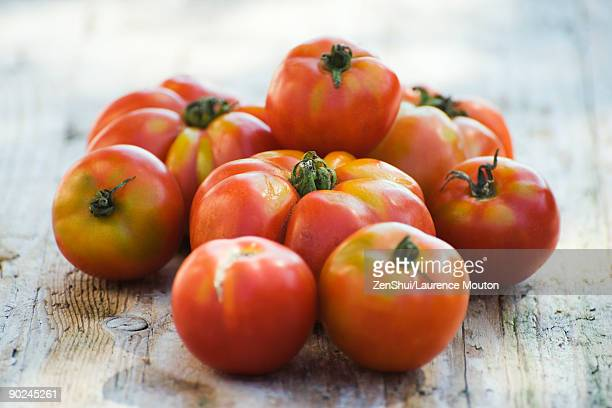 pile of ripe tomatoes - ugly wallpaper stock photos and pictures