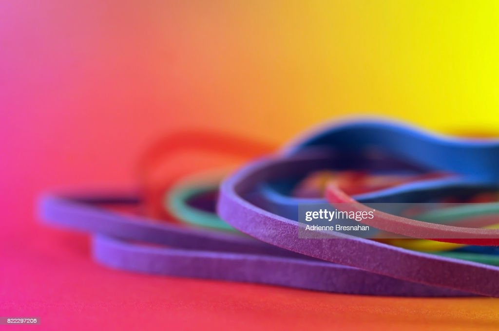 Pile of Rubber Bands on Rainbow Background : Stock Photo