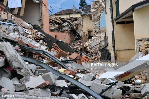 A pile of rubble is pictured in the main street of the devastated small village of Onna on April 12 epicentre of the April 6 earthquake that stroke...
