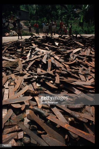 A pile of rusted machetes show the destruction June 16 1994 near Kigali Rwanda Three months after the fighting began 500000 Rwandans had been killed...