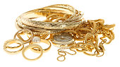 A pile of scrap gold jewelry on a white background
