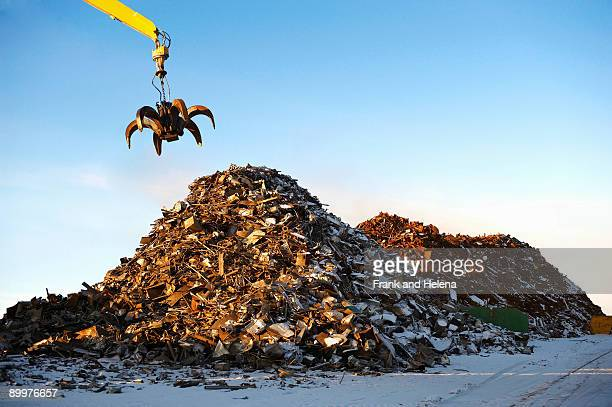 pile of scrap metal with crane - garbage dump stock pictures, royalty-free photos & images