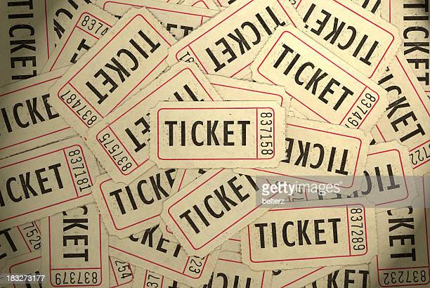 A pile of several white, black and red ticket stubs