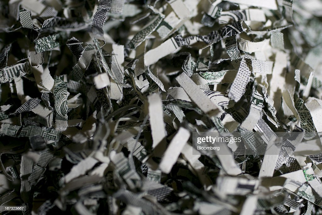 A pile of shredded U.S. currency is arranged for a photograph in Washington, D.C., U.S., on Wednesday, April 24, 2013. The S&P 500 has surged 134 percent from a 12-year low in 2009 as corporate earnings beat estimates and the Federal Reserve embarked on three rounds of bond purchases to stimulate the economy. Photographer: Andrew Harrer/Bloomberg via Getty Images