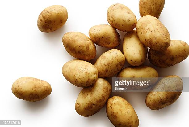Pile of small baby potatoes on a white background