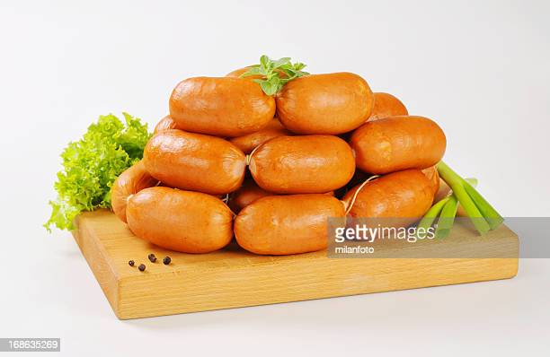 Pile of small sausages on a cutting board