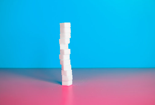 pile of sugar cubes with blue background and red background - gettyimageskorea