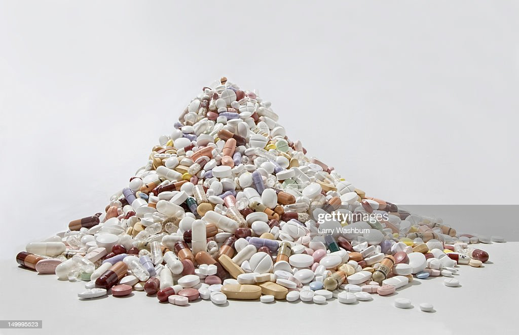 A pile of tablets, pills, and capsules : Stock Photo