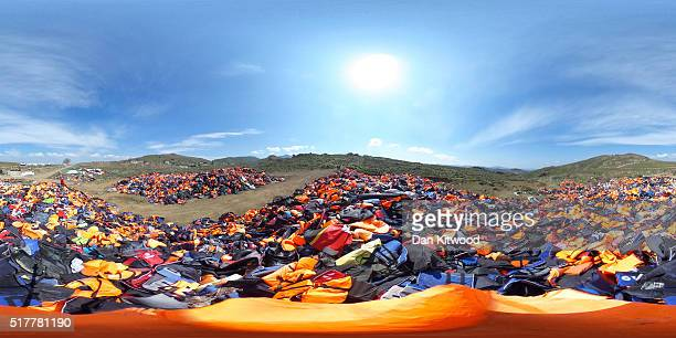 A pile of thousands of discarded life vests are dumped in a valley in hills above the town on March 27 2016 in Mithymna Greece New boat arrivals on...