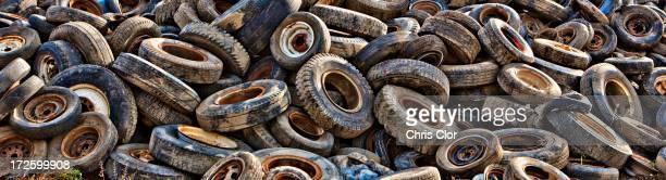 Pile of tires in junkyard
