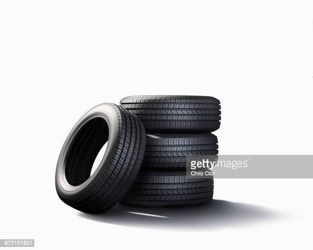 Pile of tires on white background