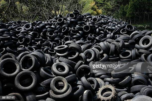 pile of tires - environmental damage stock pictures, royalty-free photos & images